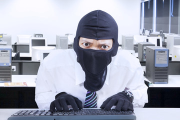 Businessman wearing mask stealing information 1
