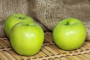 green apples on a burlap background