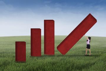 Businesswoman builds profit chart outdoors