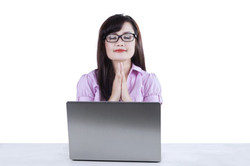 Businesswoman praying while working isolated