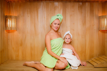 Mother and daughter in the sauna