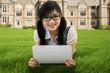 Cute student using digital tablet outdoor