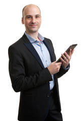 young male executive using digital tablet