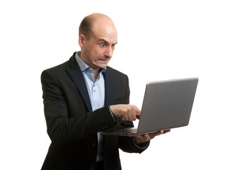 Angry businessman with laptop computer