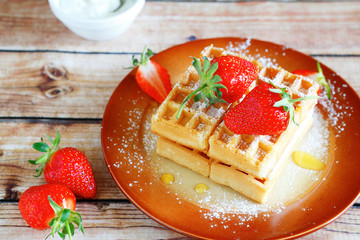strawberry waffles on a plate