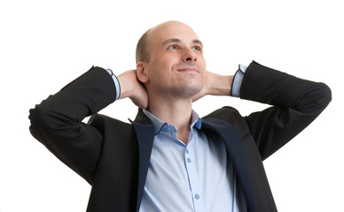 businessman while relaxing with hands behind head