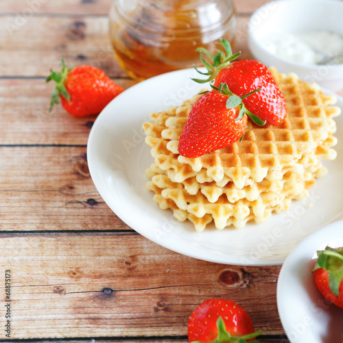 canvas print picture waffles with strawberries and cream on a plate