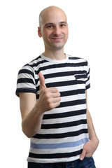 Handsome casual man holds his thumbs up
