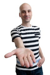 man holds out his hand with the palm facing upwards