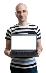 confident young man advertising laptop