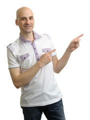 Man in polo t-shirt pointing to copy space