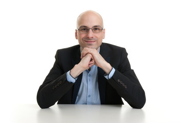 cheerful businessman sitting at a table