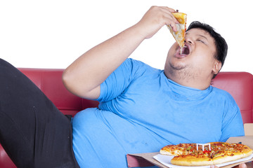 Obese person eats pizza 2