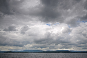 Fjord landscape of dramatic sky and sea