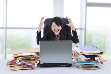 Stressful businesswoman screaming in office 1