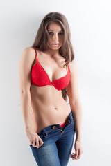 Sexy brunette advertises fashionable red underwear