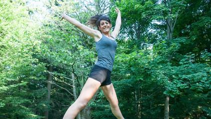 beautiful athlete girl jump on Camaldoli park
