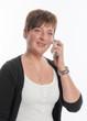 canvas print picture - Junge Frau telefoniert mit Handy