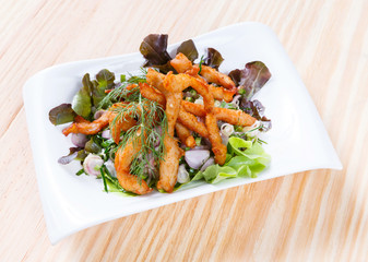 Spicy salad with deep fried marinated chicken