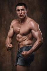 Strong muscular man. Naked torso.
