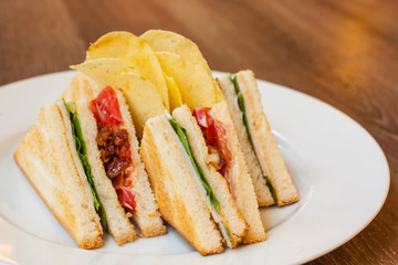 club sandwich with bacon and egg
