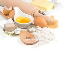 baking ingredients eggs, flour, yeast, sugar, butter. kitchen ut