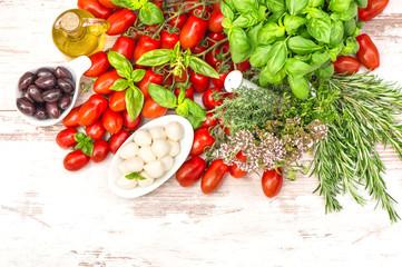 tomatoes, basil leaves, mozzarella and olive oil. food backgroun
