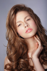Tenderness. Young Woman with Long Healthy Loosing Hair