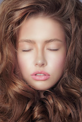 Daydream. Pensive Woman's Face with Closed Eyes and Curly Hair