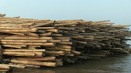 Side of bamboo rafts on the mekong towed by a boat (2)