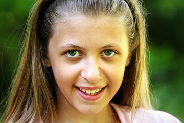 Portrait of a smiling beautiful young girl