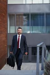 Businessman in a suit walking