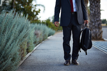 Businessman in a suit walking