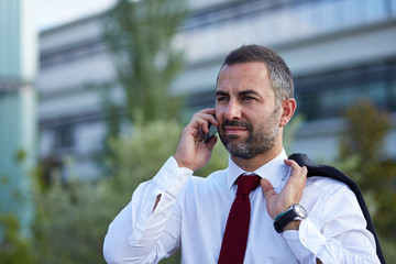 Businessman in a suit on the phone