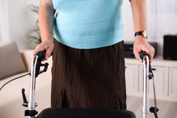 close up shot of elderly woman using walker rehab