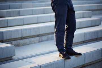 Businessman standing in stairs
