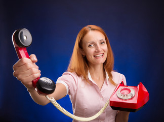 Redhead women with red telephone.