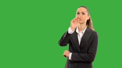 Young beautiful business woman touches the invisible screen