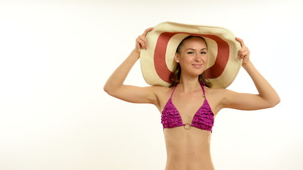 young beautiful girl in a bathing suit and beach hat