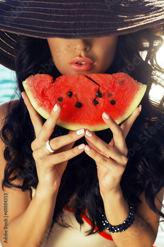 sexy girl with dark hair eating watermelon - 68884353