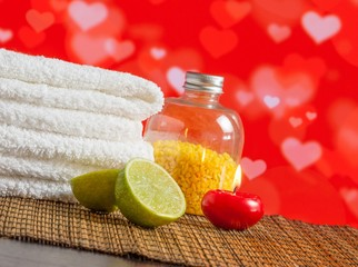 Spa massage with towel red candle and lime for valentine day