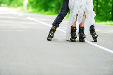the groom and the bride skate on roller-skaters