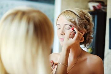 bride and makeup artist