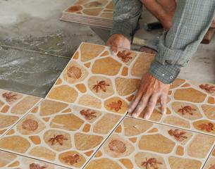 Tiler install ceramic tiles