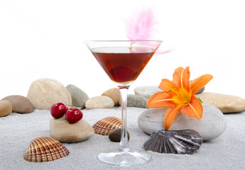 Cherry cocktail in a environment of sand and pebble stones