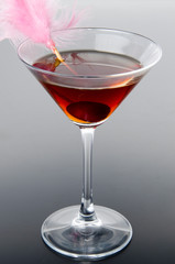 Cherry cocktail on a gray background