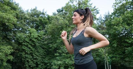 female athlete running on park
