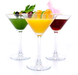 Composition with a orange, cherry and green vegetables cocktails