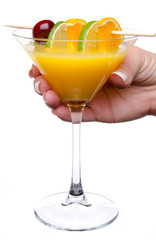 Woman's hand holding a orange cocktail