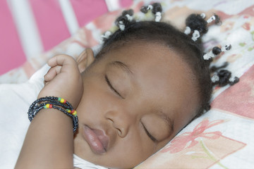 Adorable baby girl sleeping in her room (one year old)